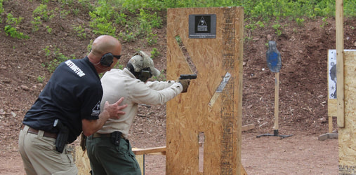 Cajun Arms pistol training with cover